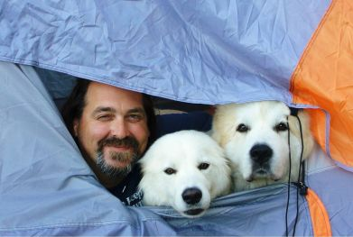 Luke Robinson and his two dogs, Murphy and Hudson, peer from a tent during his canine cancer awareness walk from Austin, Tex. to Boston in 2008. (Marei Burnfield)